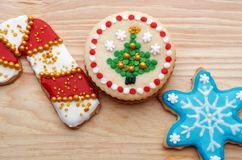 Decorated Christmas Cut Out Cookies on Natural Wood Grain. Highly decorated and colorful Christmas cut out cookies that are homemade and set on natural wood Royalty Free Stock Photos