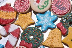 Decorated Christmas Cut Out Cookies on Silver Platter. Highly decorated and colorful Christmas cut out cookies that are homemade and set on a silver platter Royalty Free Stock Photography