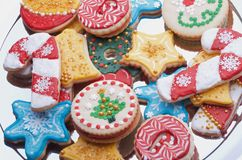 Decorated Christmas Cut Out Cookies on Silver Platter. Highly decorated and colorful Christmas cut out cookies that are homemade and set on a silver platter Stock Images