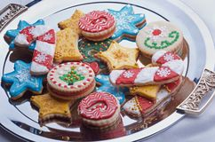 Decorated Christmas Cut Out Cookies on Silver Platter. Highly decorated and colorful Christmas cut out cookies that are homemade and set on a silver platter Stock Image