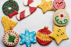 Decorated Christmas Cut Out Cookies on White. Highly decorated and colorful Christmas cut out cookies that are homemade and set on white with copy space in the Stock Photos