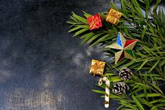 Decorated Christmas decorations on black stone floor.  royalty free stock photography