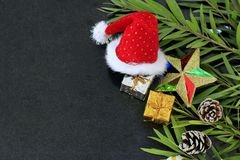 Decorated Christmas decorations on black stone floor.  royalty free stock image