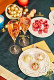 Decorated Christmas dining table. With champagne and delicious snacks Royalty Free Stock Photography