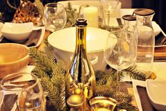 A decorated christmas dining table. Christmas table decorated with candles and christmas decorative objects. Festive christmas table place setting at home with Stock Image