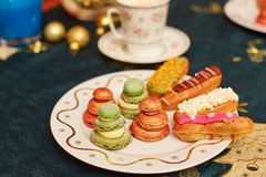 Decorated Christmas dining table with delicious eclairs Stock Images