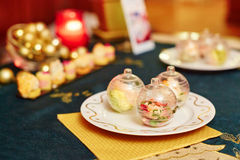 Decorated christmas dining table. With delicious starter on the plate Royalty Free Stock Photos