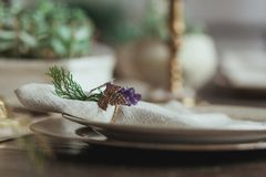 Decorated Christmas Dinner Table Setting of empty dish and sackcloth rustic napkin with decor ring in the form of grapes Royalty Free Stock Photography
