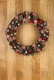 Decorated Christmas Door Wreath Gingham Stars on Sapele Wood Bac Royalty Free Stock Images