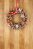 Decorated Christmas Door Wreath Red White Cloth Stars on Sapele Stock Photography
