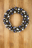 Decorated Christmas Door Wreath White Stars and Blue Pearls on S Royalty Free Stock Image