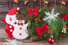 Decorated Christmas fir branch on a dark wooden background Stock Images