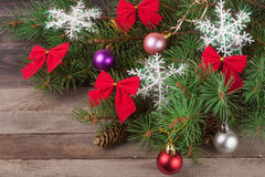 Decorated Christmas fir branch on an old wooden background Stock Photo
