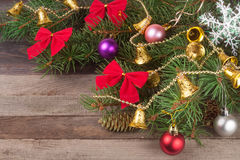 Decorated Christmas fir branch on an old wooden background Royalty Free Stock Images