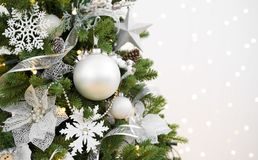 Decorated Christmas fir tree on abstract sparkling background with copyspace stock image