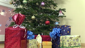 Decorated christmas fir tree and colorful gifts presents boxes stock footage