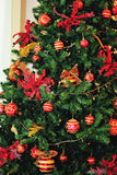 Decorated Christmas fir tree with garland and balls. Decorated Christmas fir tree with red garland and balls Royalty Free Stock Photos