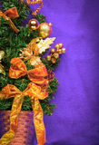 Decorated Christmas Fir Tree on violet background Royalty Free Stock Photo