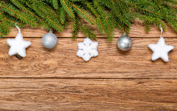 Decorated Christmas fir tree on a wooden board Royalty Free Stock Images