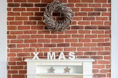 Decorated Christmas fireplace on a brick wall Royalty Free Stock Photo