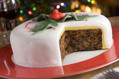 Decorated Christmas Fruit Cake with slices taken. Out royalty free stock photos