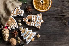 Decorated Christmas gingerbread cookies on a wooden background w royalty free stock photo