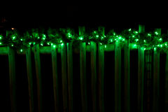 Decorated with Christmas green lights on fence Royalty Free Stock Photography