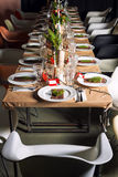 Decorated Christmas holiday table ready for dinner Stock Images