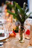 Decorated Christmas holiday table ready for dinner Royalty Free Stock Images