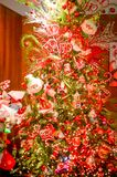 Decorated Christmas Holiday Tree with Elves. A decorated Christmas tree with elves, candy canes and lights and Ho, ho, ho royalty free stock photo