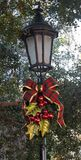 Decorated Christmas Lamppost. A decorated Christmas Lamppost reminds those passing by of the Holiday Season Royalty Free Stock Photos