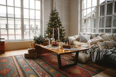 Decorated Christmas room with beautiful fir tree. Near the window stock images