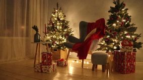 Decorated Christmas room HD video. Christmas tree and gifts. Shimmering garland stock footage