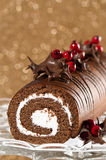 Decorated Christmas Roulade. Christmas roulade decorated with chocolate dipped holly leaves Royalty Free Stock Image