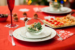 Decorated Christmas table with delicious salad Stock Photos