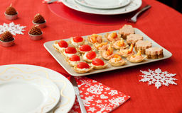 Decorated Christmas table with tasty tartlets Stock Images