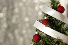 Decorated Christmas tree. Against the holiday background Stock Photo