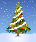 Decorated Christmas tree. Christmas tree on a winter background Royalty Free Stock Photography
