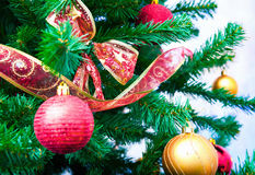 Decorated Christmas tree. Bauble decorations and ribbons on green Christmas tree Stock Images