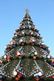 Decorated Christmas tree on the background of blue sky Royalty Free Stock Images
