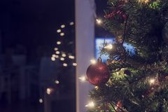 Decorated Christmas tree with party lights. Decorated Christmas tree with a background bokeh of twinkling party lights and reflection of television screen with Royalty Free Stock Photo