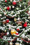 Decorated Christmas tree with balls, garland on fair. Outdoor. Xmas card and pattern. Winter stock photography