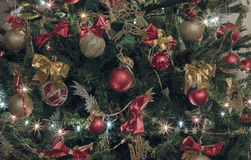 Decorated Christmas tree with baubles, bows, lights Royalty Free Stock Image