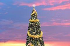 Decorated Christmas Tree on beatiful sunset background in Lake Buena Vista area. Orlando, Florida. November 20, 2018 . Decorated Christmas Tree on beatiful stock photo