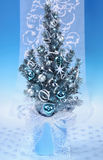 Decorated Christmas tree on blue background Stock Photos