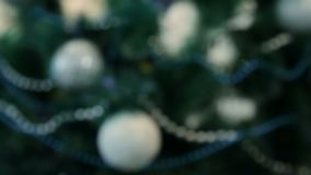 Decorated Christmas tree with blue lights. White Christmas ball and garland.  stock footage