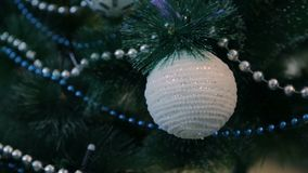 Decorated Christmas tree with blue lights. White Christmas ball and garland.  stock video