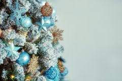 Decorated christmas tree on blurred defocused background. Decorated christmas tree on blurred defocused pattern background Royalty Free Stock Photo