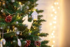 Decorated christmas tree on blurred defocused background. Decorated christmas tree on blurred defocused pattern background Royalty Free Stock Photos