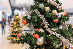 Decorated Christmas tree on blurred, sparkling and fairy background Stock Photo